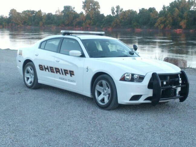 A Sheriff's vehicle parked by the lake.